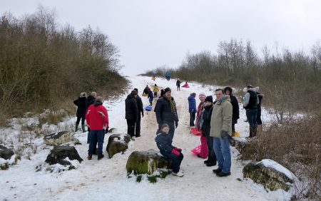 Photo of people tobogganing on the Tump.
