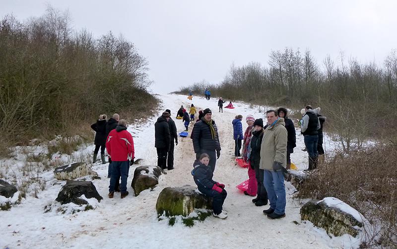 Photo of people tobogganing on the Tump.