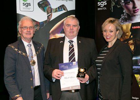 Photo of Alfred Sollars receiving his award.