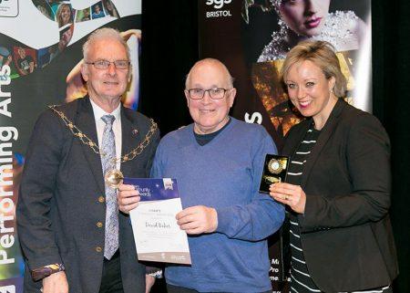 Photo of David Baker receiving his award.