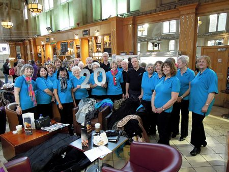 Photo of Stokes Singers in the café at Bristol Temple Meads Station.