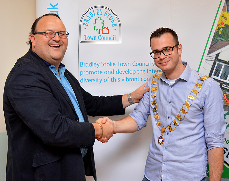Photo of Cllr Ben Randles (right) being congratulated by the previous office holder, Cllr Andy Ward.
