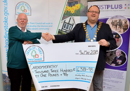 Photo of Cllr Andy Ward presenting a charity cheque to Steve Holliday, south west representative for Cardiomyopathy UK.