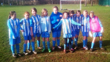 Photo of he current U16 team as young players in the early days of girls' football at BSYFC.