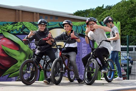 Photo of three young BMX riders at the 2017 skate park competition.