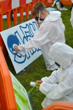 Photo of youngsters taking part in a 'have a go' street art session.