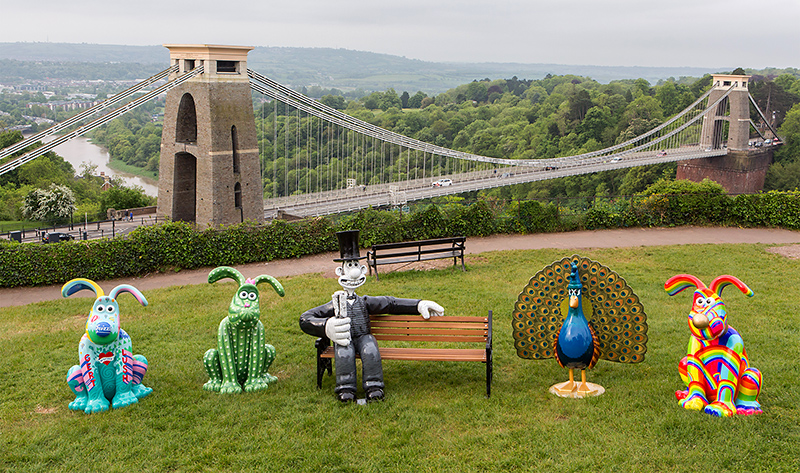 Photo of some of the Gromit Unleashed 2 sculpture trail figures with the Clifton Suspension Bridge in the background.