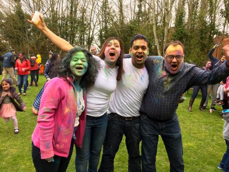 Photo of people enjoying powder paint throwing at a previous SGAP event.