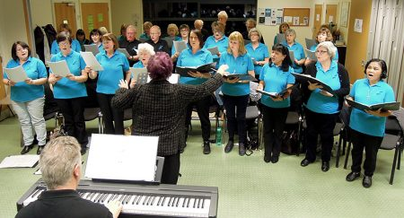 Photo of Stokes Singers in rehearsal for their 25th anniversary concert.
