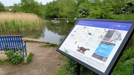 Photo of the interpretation panel at the lake.