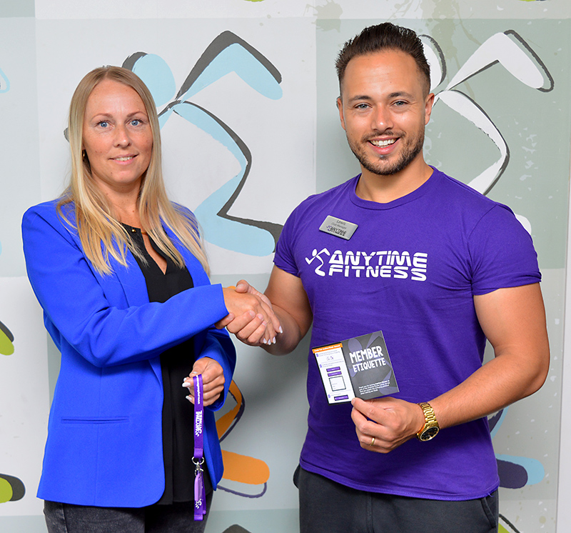 Photo of Kasia Bedkowska receiving her membership key from Lewis Erskine, club manager at Anytime Fitness Bradley Stoke.
