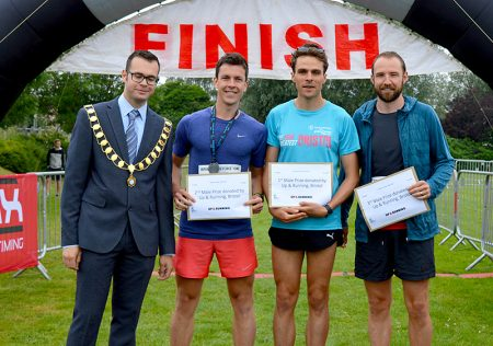 Photo of Bradley Stoke mayor Ben Randles with the first three male finishers.