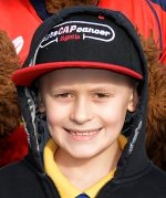 Photo of Bailey Cooper wearing a Let's CAP Cancer cap.
