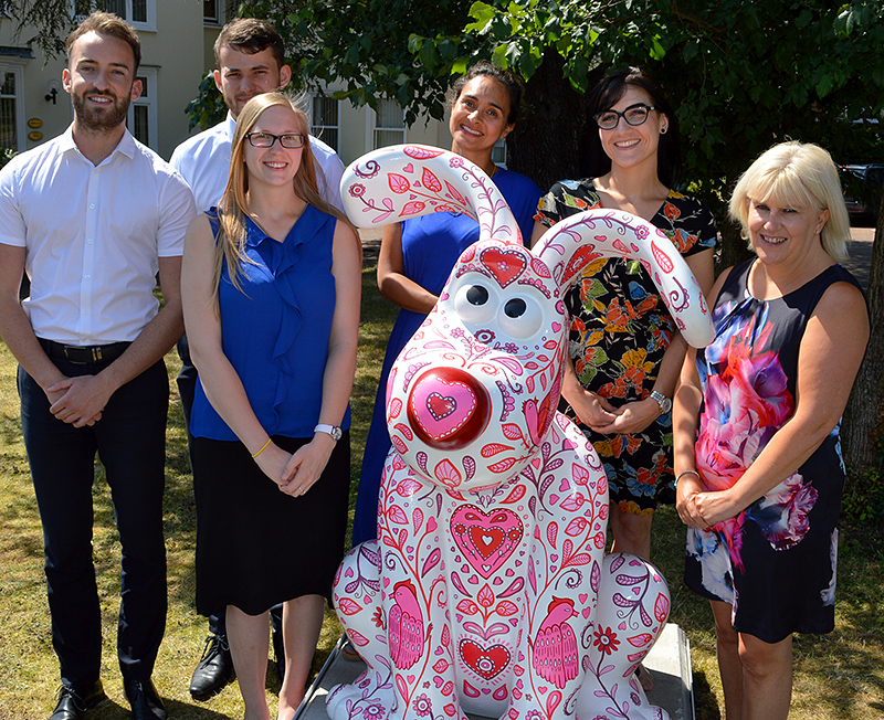 Photo of Dunkley's staff welcoming Cupid.