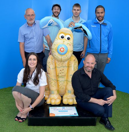 Photo of staff at the Willow Brook Centre with their 'Swallows and Amazons' Gromit figure.
