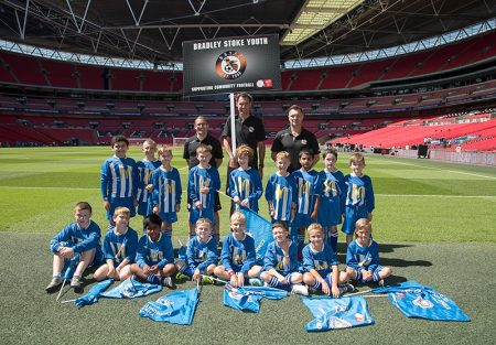 Coaches and players of BSYFC U8 Whites pictured at Wembley Stadium prior to performing their pre-match duties