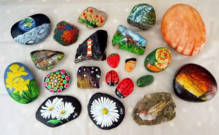Photo showing a selection of pebbles painted by Stokes Art Group.