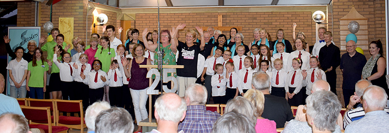 Photo of performers at the end of the Stokes Singers summer concert.