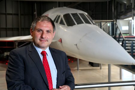 Photo of Jack Lopresti MP with Concorde in the background.