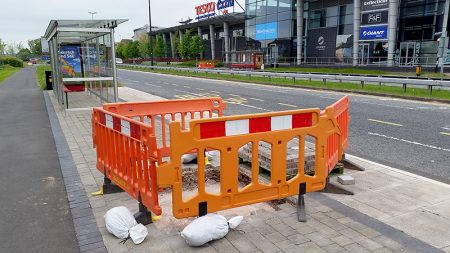 Photo showing further installation work taking place at the southbound 'Willow Brook Centre' MetroBus stop on Bradley Stoke Way.