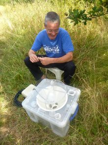 Photo of moth expert Peter Cranswick with one of his traps.