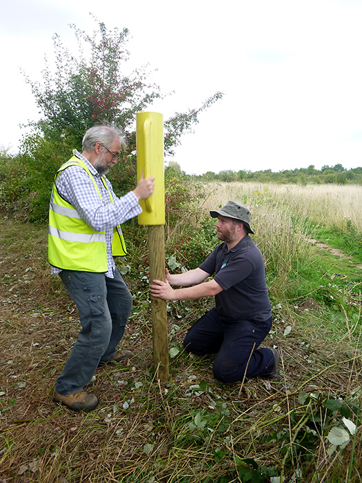 Photo of volunteers installing marker posts around the perimeter of the Tump.