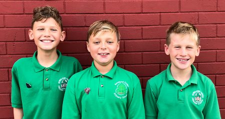 Photo of the Bowsland Green 'Swim the Channel' team in school uniform.