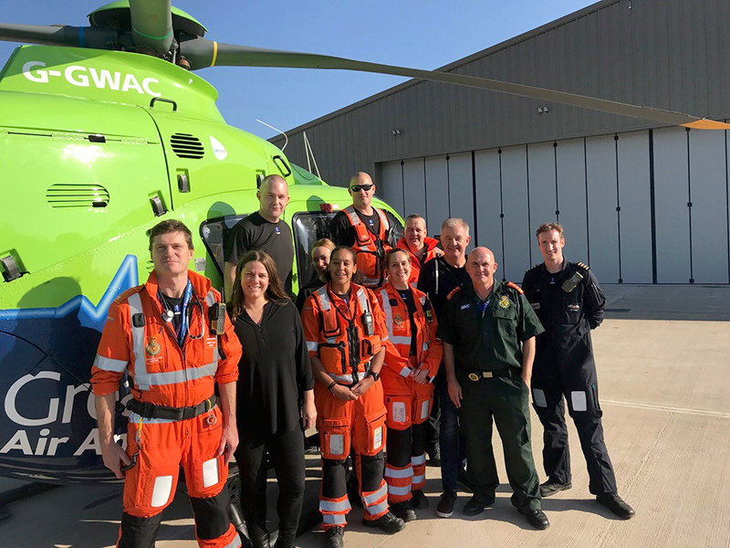 Photo of GWAAC crew with air ambulance G-GWAC on the apron of the new Almondsbury air base
