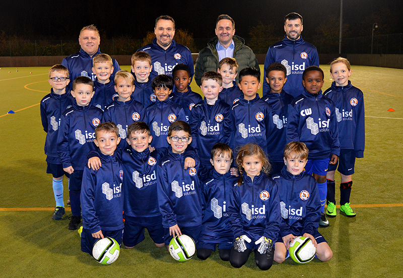 Group photo of the team wearing the new training kit showing the ISD Solutions logo.