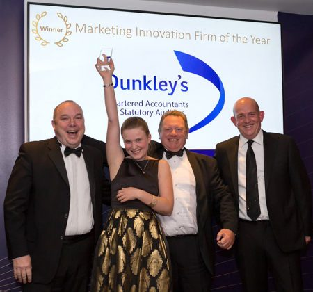 Photo of the award winners with Dunkley's marketing manager Nicole Crompton and Mike Dunkley in the centre.