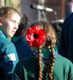 Photo of a poppy in a Scout's hair at the Remembrance ceremony.