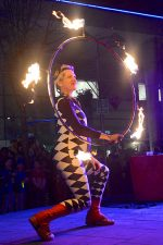 Photo of a fire juggler.