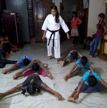 Photo of Khushi Ashwin teaching self-defence karate to a group of young girls at a shelter home in India.