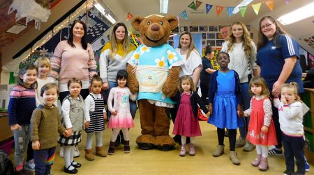 Photo of staff and children at the Mama Bear's Day Nursery setting at Baileys Court.
