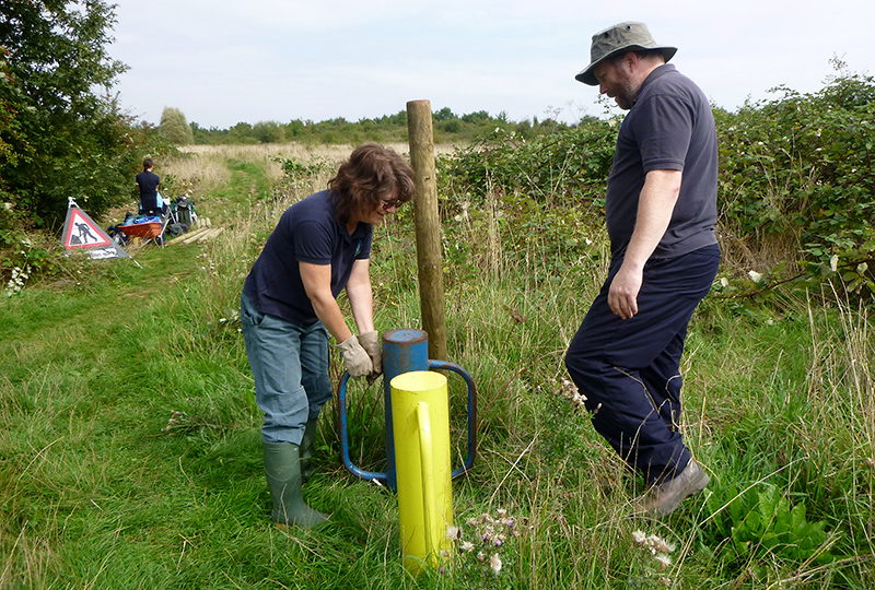 Photo of conservation group volunteers installing wooden posts on the Tump.