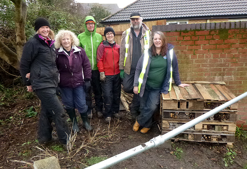Photo of Bradley Stoke in Bloom volunteers with an insect hotel at Manor Farm Corner.
