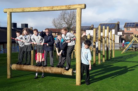 Photo of children standing on play equipment at St Michael's Primary School.