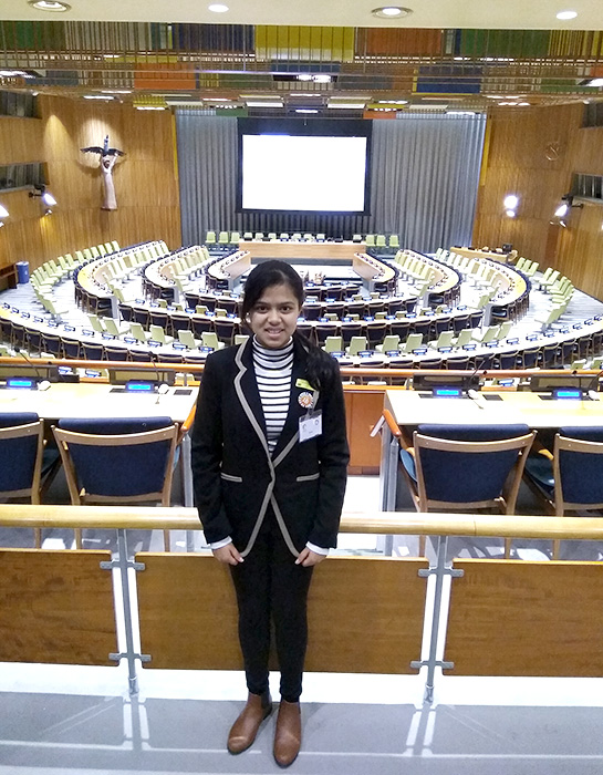 Photo of Khushi in the chamber of the Trusteeship Council.