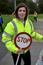 Photo of Esther Huke, dressed as a lollipop lady.