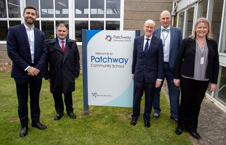 Photo of schools minister Nick Gibb MP (centre) on a visit to Patchway Community School.