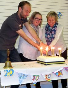 Photo of current headteacher Phil Winterburn and former heads Lois Haydon and Chris Dursley cutting an anniversary cake.