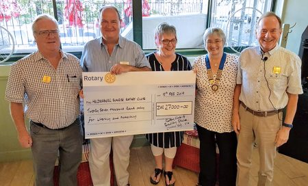 Photo of members of Bradley Stoke Rotary Club presenting a donation to a school in Cape Town