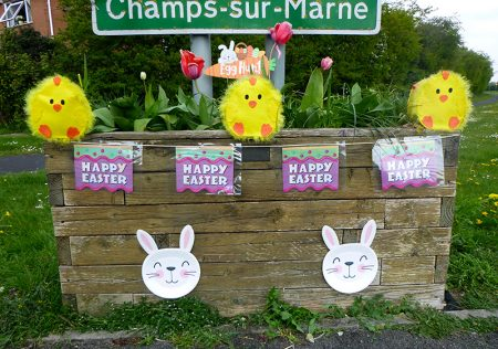 Photo of Easter decorations on a 'Welcome' planter.