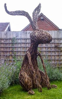 Photo of a large wicker rabbit created by sculptor Tom Hare.