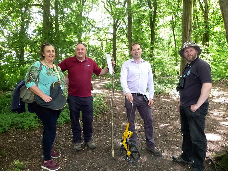 Photo of volunteers from the conservation group planning and marking the route of the new woodland paths.
