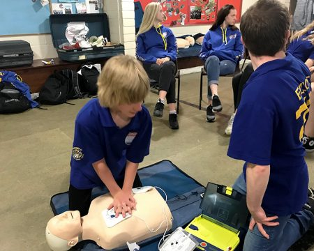 Photo of two Scouts practising CPR on a dummy.