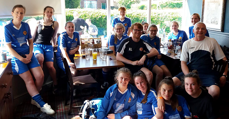 Photo of the Bradley Stoke Ladies FC first team squad, with manager Martin Lee and assistant manager Ross Lee, relaxing after their final match of the 2018/19 season, against league winners Cheltenham Town.