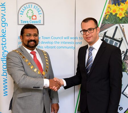 Photo of Cllr Tom Aditya (left) being congratulated by the previous office holder, Cllr Ben Randles.