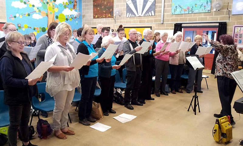 Photo of the singing workshop in progress.