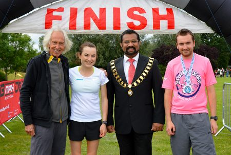 Photo of race winners Helen Newberry (2nd from left) and Sam Cotterell (right).